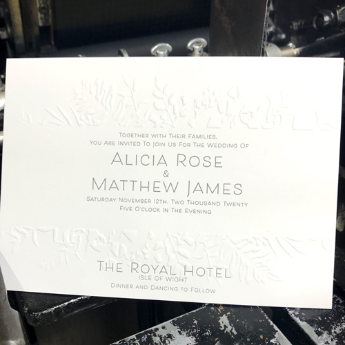 Embossed and letterpress wedding invitation